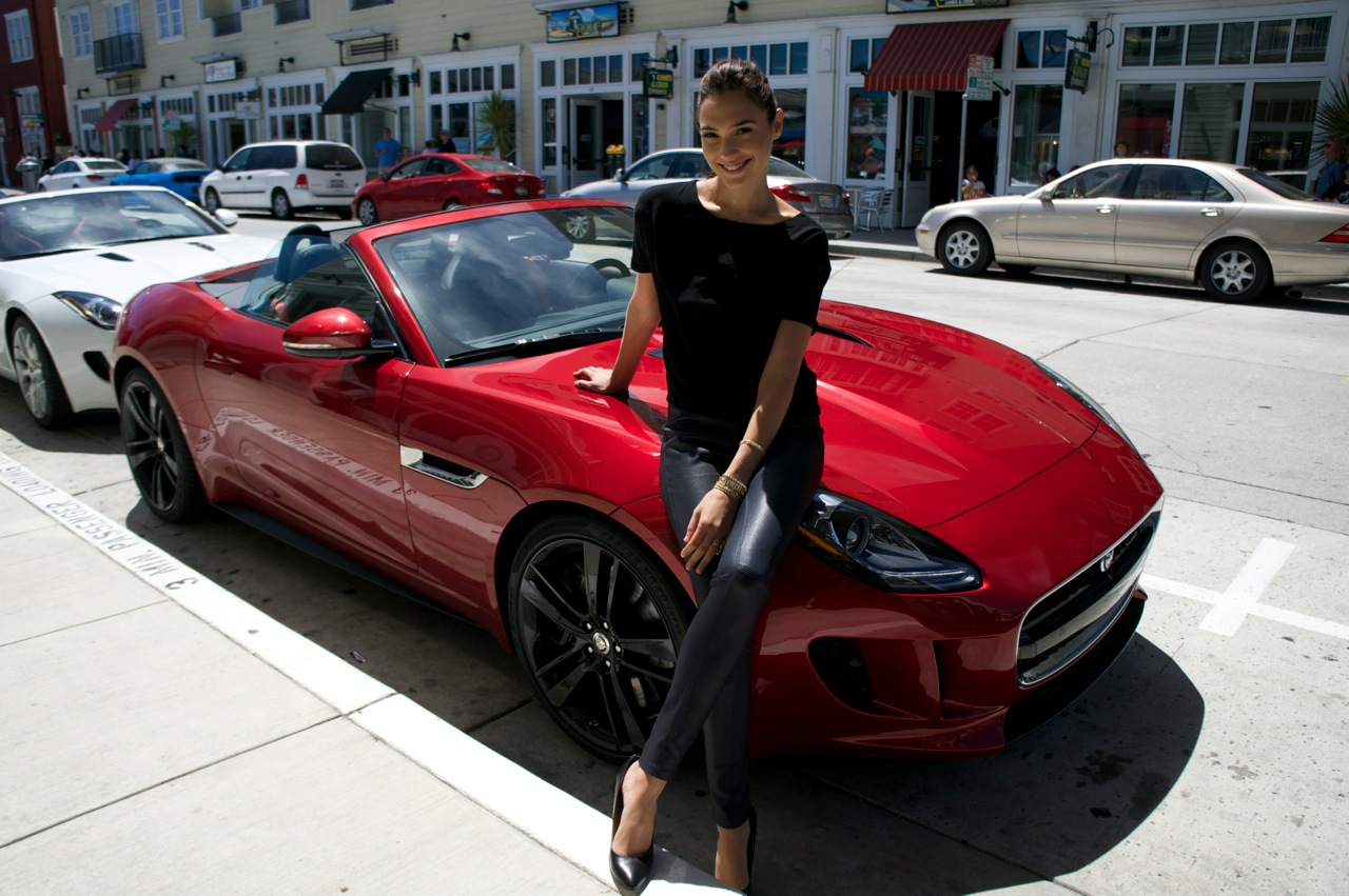 Gal Gadot infront of a red car